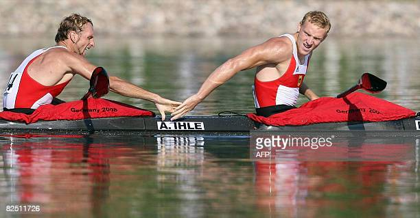 Germany's Martin Hollstein and Andreas Ihle celebrate after winning the 2008 Beijing Olympic Games Men's Kayak K2 1000m flatwater final at the Shunyi...