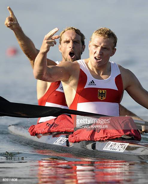 Germany`s Martin Hollstein and Andreas Ihle celebrate after winning the mens Kayak double 1000m of the 2008 Beijing Olympic Games at the Shunyi...