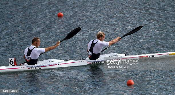 Germany's Martin Hollstein and Andreas Ihle compete in the kayak double 1000m men's heats during the London 2012 Olympic Games at Eton Dorney Rowing...