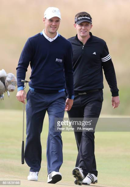 Germany's Martin Kaymer and England's Garrick Porteous during day one of the 2013 Open Championship at Muirfield Golf Club East Lothian