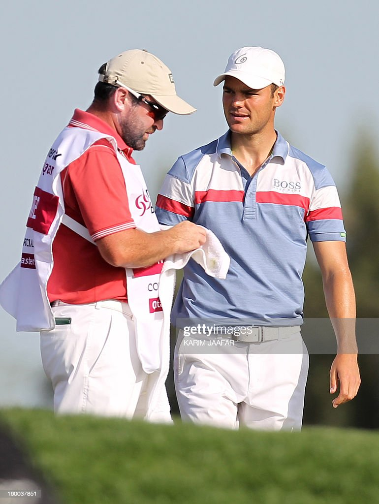 Germany's Martin Kaymer (R) chats with his caddie during the third round of the Qatar Masters golf tournament in Doha on January 25, 2013.
