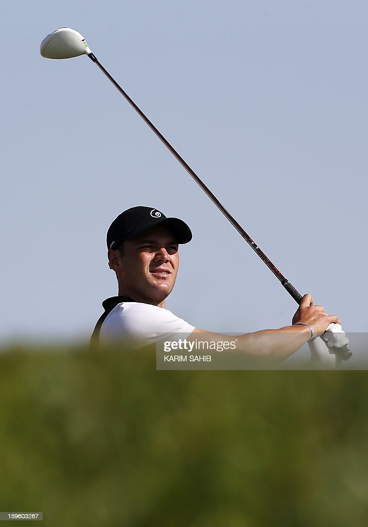 Germany's Martin Kaymer follows a shot during the first round of the Abu Dhabi Golf Championship at the Abu Dhabi Golf Club in the Emirati capital on January 17, 2013.