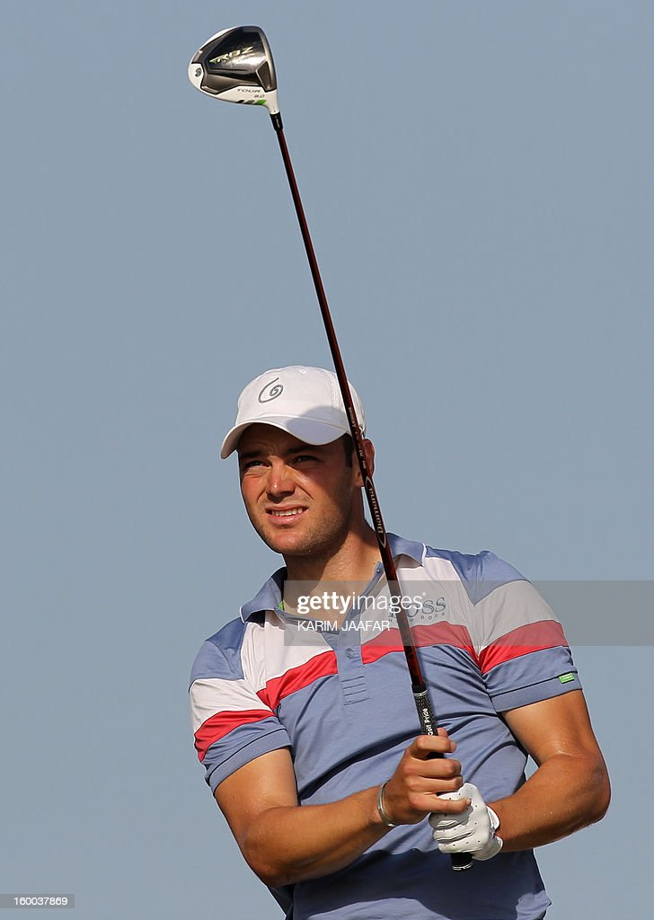 Germany's Martin Kaymer follows a shot during the third round of the Qatar Masters golf tournament in Doha on January 25, 2013.