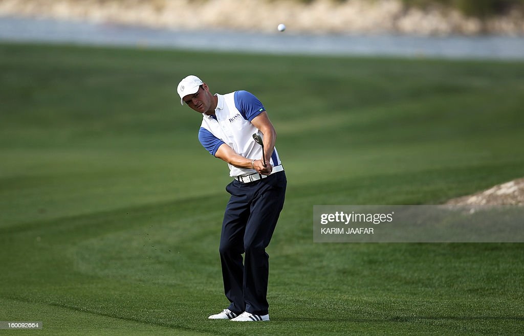 Germany's Martin Kaymer plays a shot during the final round of the Qatar Masters Golf Tournament in the capital Doha, on January 26, 2013.