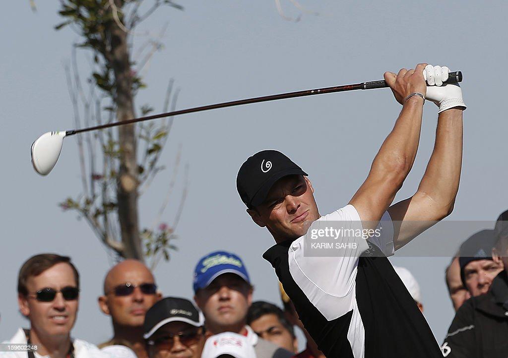 Germany's Martin Kaymer plays a shot during the first round of the Abu Dhabi Golf Championship at the Abu Dhabi Golf Club in the Emirati capital on January 17, 2013. AFP PHOTO/KARIM SAHIB
