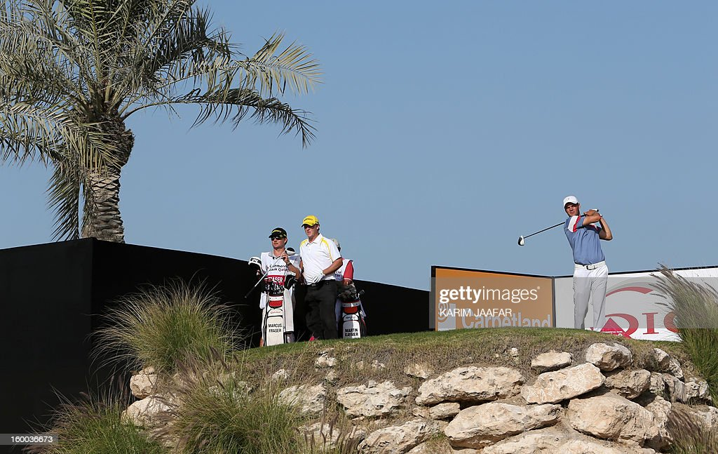 Germany's Martin Kaymer plays a shot during the third round of the Qatar Masters golf tournament in Doha on January 25, 2013. AFP PHOTO / AL-WATAN DOHA / KARIM JAAFAR == QATAR OUT ==