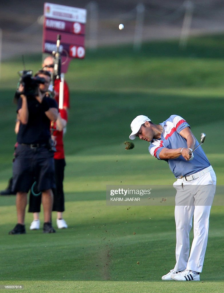 Germany's Martin Kaymer plays a shot during the third round of the Qatar Masters golf tournament in Doha on January 25, 2013.