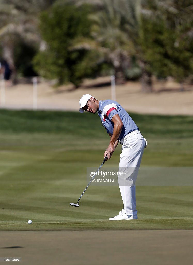 Germany's Martin Kaymer takes his shot during the third round of the Abu Dhabi Golf Championship at the Abu Dhabi Golf Club in the Emirati capital on January 19, 2013.
