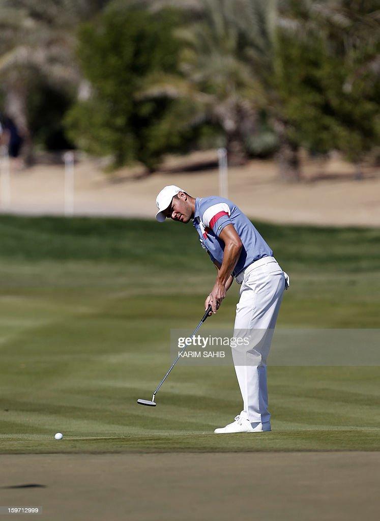 Germany's Martin Kaymer takes his shot during the third round of the Abu Dhabi Golf Championship at the Abu Dhabi Golf Club in the Emirati capital on January 19, 2013. AFP PHOTO/KARIM SAHIB