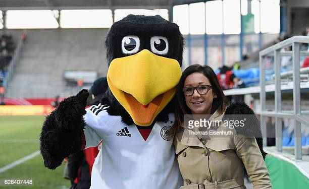 Germany's mascot Paule and Nadine Kessler pose for a photo prior to the women's international friendly match between Germany and Norway at...