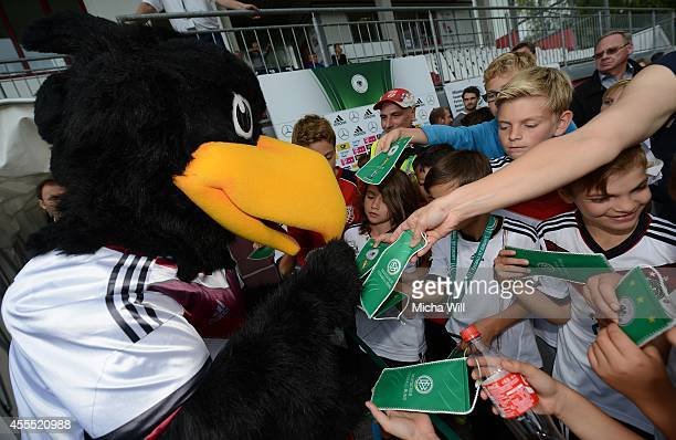 Germanys mascot Paule signs autographs prior to the KOMM MIT tournament match between U17 Germany and U17 Israel on September 14 2014 in Rain am Lech...
