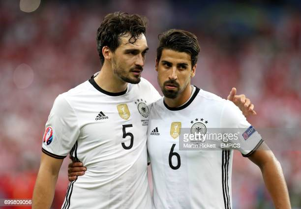 Germany's Mats Hummels and Germany's Sami Khedira react after the final whistle