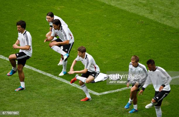 Germany's Mats Hummels Mesut Ozil Sami Khedira Thomas Muller Phillip Lahm and Jerome Boateng during the training session
