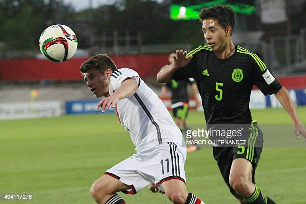 Germany's Mats Koehlert and Mexico's Ulises Torres vie for the ball during their FIFA U17 World Cup Chile 2015 football match in Talca Chile on...