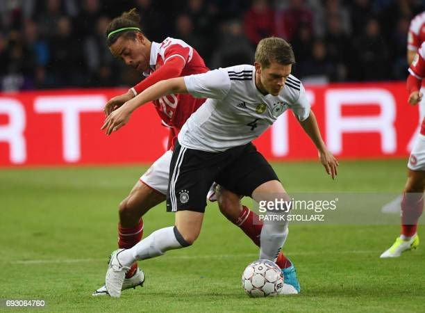 Germany´s Matthias Ginter and Denmark´s Yussuf Yurary Poulsen vie for the ball during the friendly football match between Denmark and Germany in...