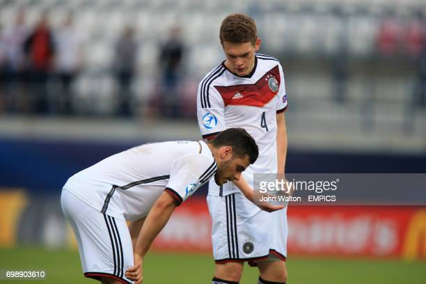 Germany's Matthias Ginter consoles teammate Kevin Volland after the final whistle