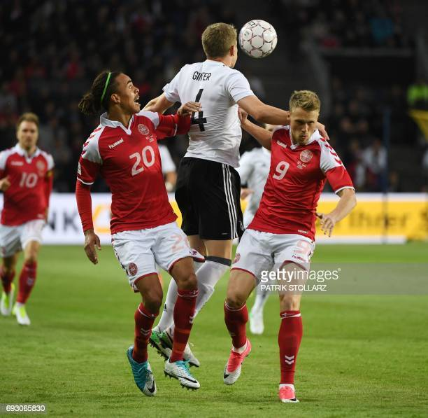 Germany´s Matthias Ginter Denmark´s Yussuf Yurary Poulsen and Denmark´s Nicolai Jorgensen vie for the ball during the friendly football match between...