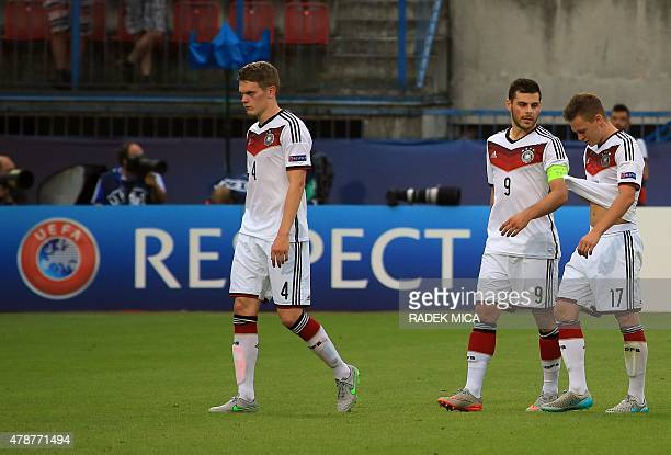 Germany's Matthias Ginter Kevin Volland and Joshua Kimmich leave the pitch after the UEFA Under 21 European Championship 2015 semi final football...