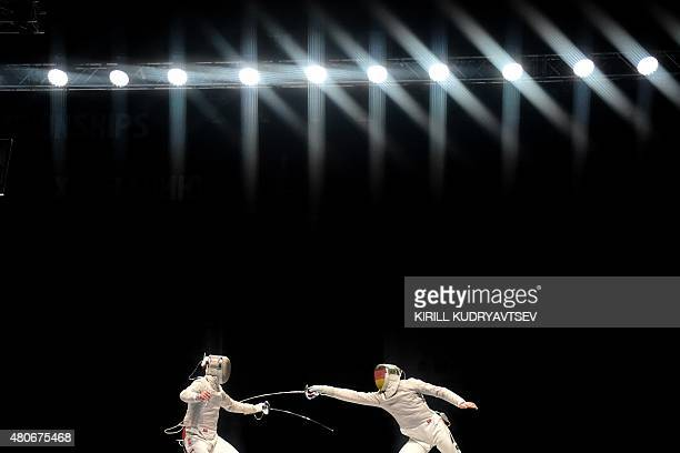 Germany's Max Hartung lunges towards Russia's Alexey Yakimenko during the men's sabre semifinal event at the 2015 World Fencing Championships in...