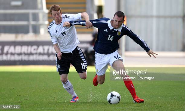 Germany's Maxilillian Arnold and Scotland's Joseph Chalmers during the International Challenge match at The Falkirk Stadium Falkirk PRESS...