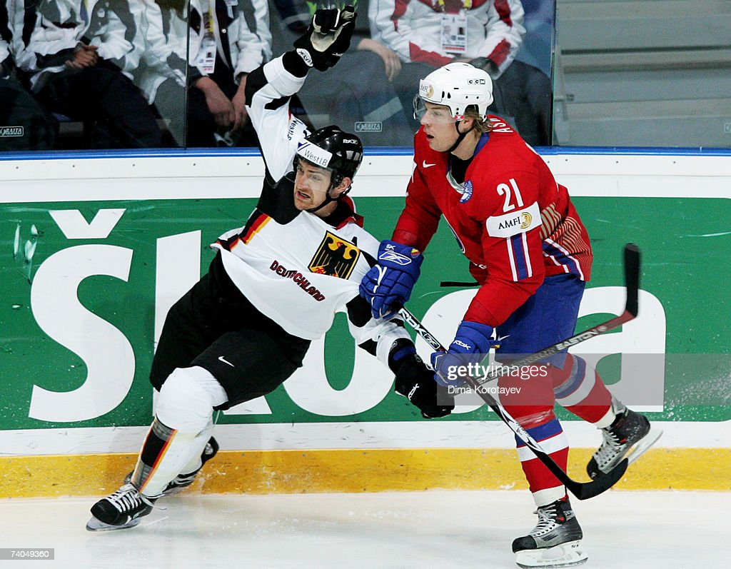 Germany's Michael Bakos fights for the puck with Norway's Morten Ask during the IIHF World Ice Hockey Championship preliminary round group C match...