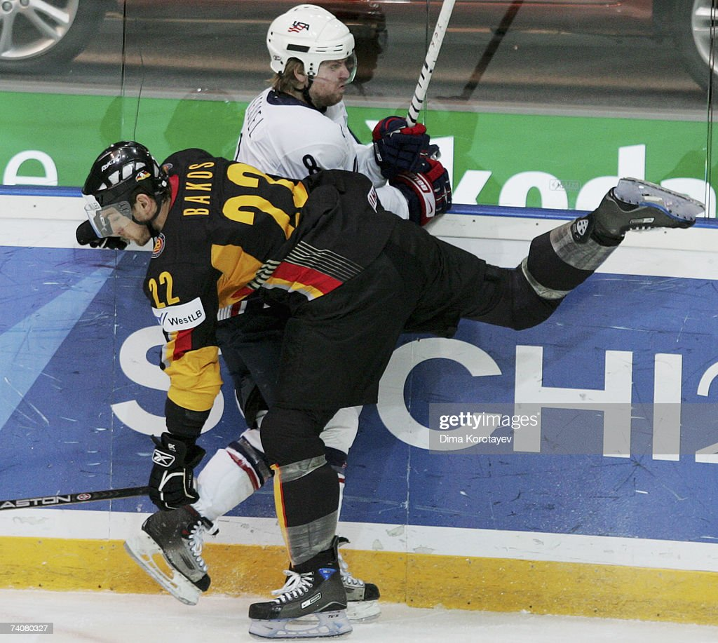 Germany's Michael Bakos fights for the puck with USA's Phil Kessel during the IIHF World Ice Hockey Championship qualifying round group F match...