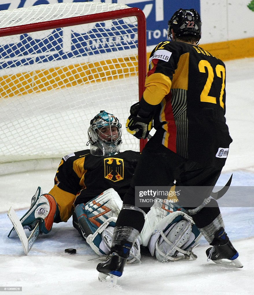 Germany's Michael Bakos stands before teammate goalie Dimitrij Patzold during the qualification round of the 2008 IIHF World Hockey Championships...