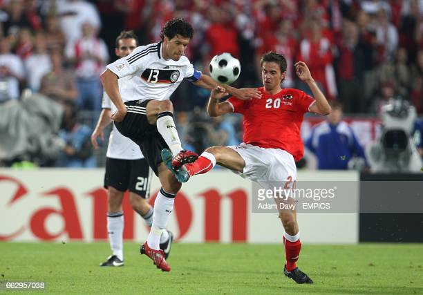 Germany's Michael Ballack and Austria's Martin Harnik battle for the ball