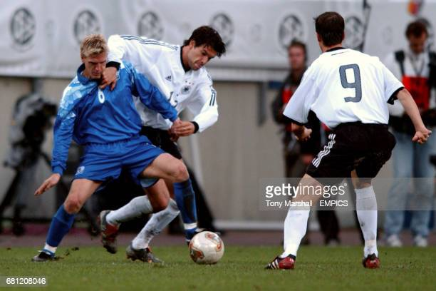 Germany's Michael Ballack and Iceland's Runar Kristinsson battle for the ball as Fredi Bobic looks on