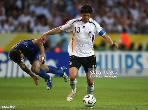 Germany's Michael Ballack pushes Italy's Gennaro Gattuso off the ball