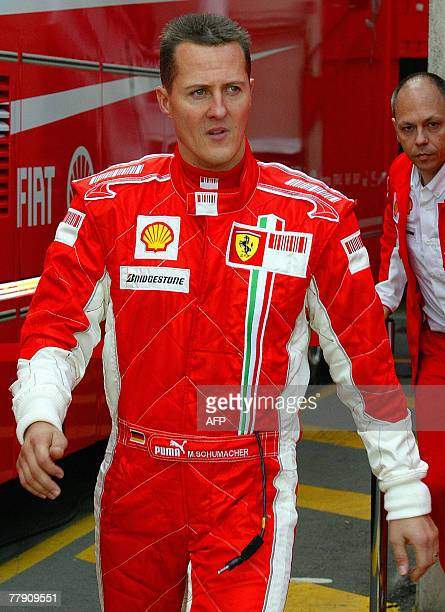 Germany's Michael Schumacher arrives to test drive Ferrari's title winning 2007 Formula One car at the Montmelo circuit in Barcelona 14 November 2007...