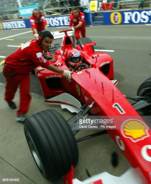 Germany's Michael Schumacher in his Ferrari is wheeled into the garage during qualifying for the British Grand Prix at Silverstone Schumacher...