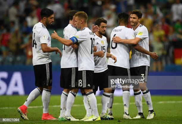 Germany's midfielder Amin Younes and team mates celebrate at the end of the 2017 Confederations Cup semifinal football match between Germany and...