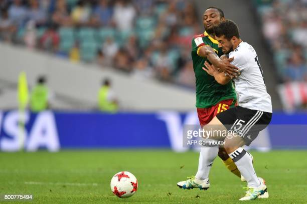Germany's midfielder Amin Younes challenges Cameroon's midfielder Sebastien Siani during the 2017 FIFA Confederations Cup group B football match...
