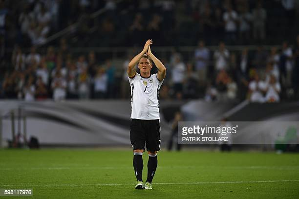 TOPSHOT Germany's midfielder Bastian Schweinsteiger leaves the pitch during the football friendly match between Germany and Finland his last game for...