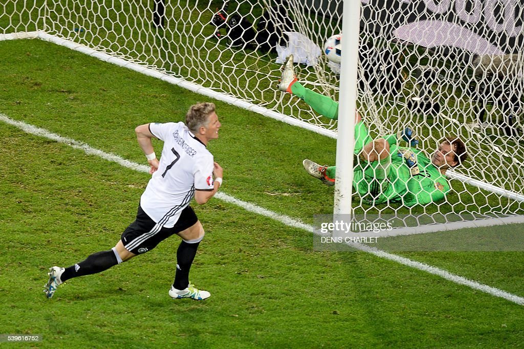 Germany's midfielder Bastian Schweinsteiger scores a goal during the Euro 2016 group C football match between Germany and Ukraine at the Stade Pierre Mauroy in Villeneuve-d'Ascq near Lille on June 12, 2016. / AFP / Denis CHARLET