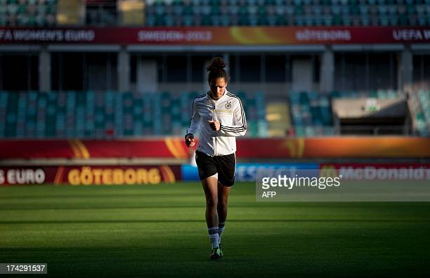 Germany's midfielder Celia Okoyino da Mbabi attends the German national team's training on July 23 2013 on the eve of the semifinal football match...