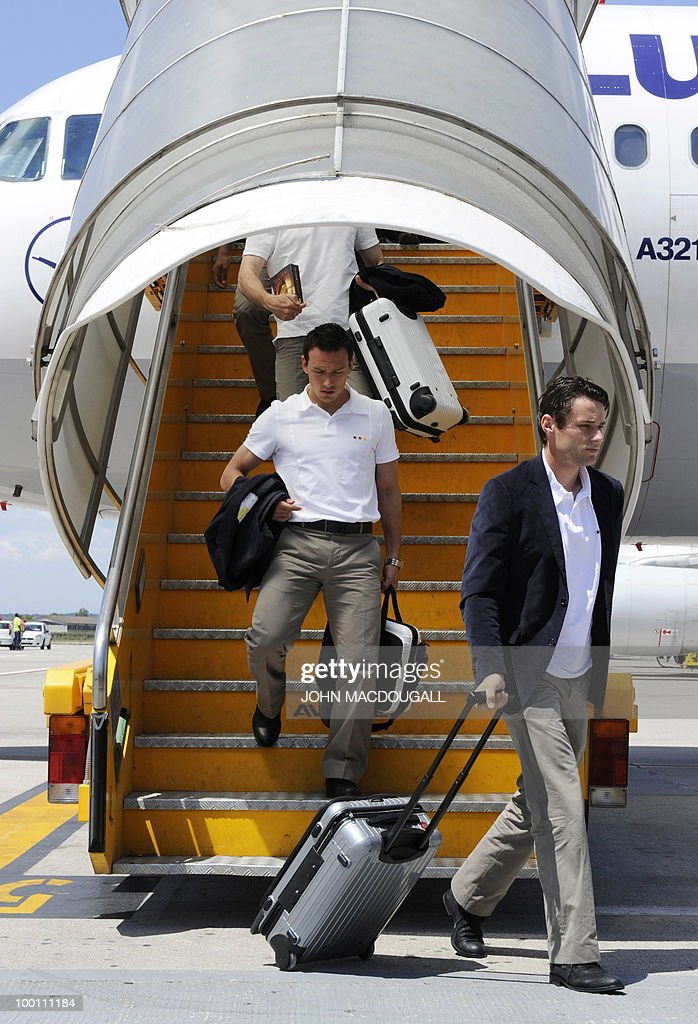 Germany's midfielder Christian Traesch (R) and Germany's midfielder Piotr Trochowski get off the plane in Verona May 21, 2010, as the German team arrives for a 12-day long training camp near Bolzano to prepare for the upcoming FIFA Football World Cup in South Africa.