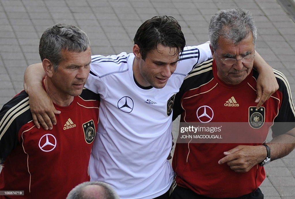 Germany's midfielder Christian Traesch (C) is walked out of the training center by team medics after sustaining a foot injury during a training match against Sued Tyrol FC at the team's training centre in Appiano, near the north Italian city of Bolzano May 24, 2010. The German football team is currently taking part in a 12-day training camp in Appiano to prepare for the upcoming FIFA Football World Cup in South Africa.