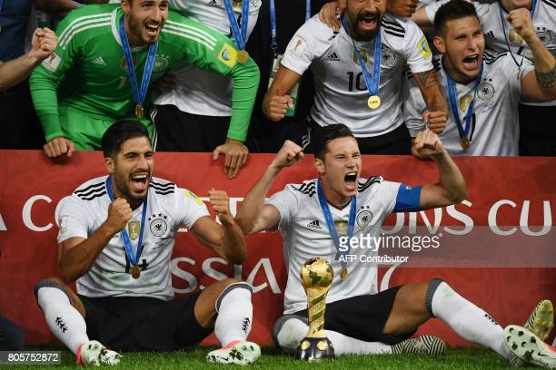 Germany's midfielder Emre Can and Germany's midfielder Julian Draxler celebrate after they beat Chile 10 in the 2017 Confederations Cup final...