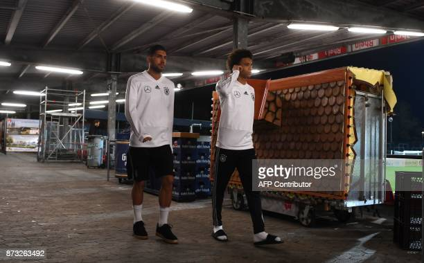 Germany's midfielder Emre Can and Germany's midfielder Leroy Sane arrive at a training session ahead of their friendly match against France at the...