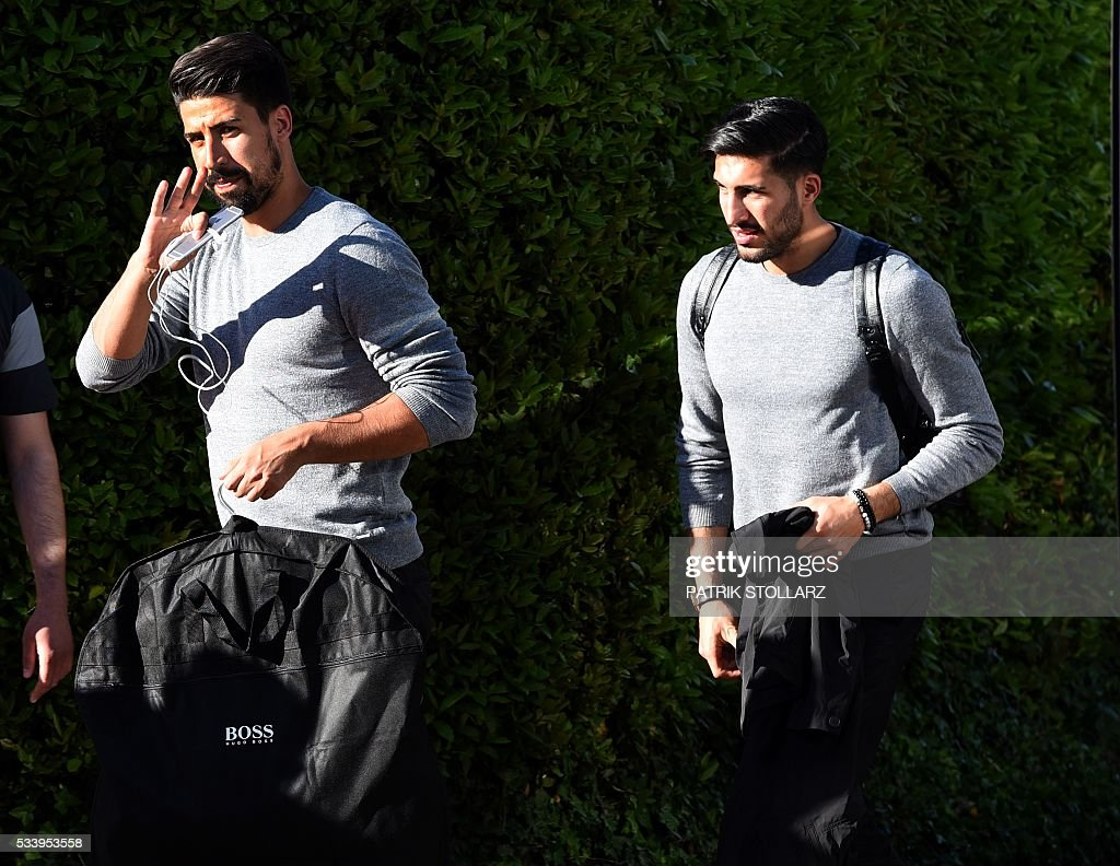 Germany's midfielder Emre Can(R) and Sami Khedira arrive at the Hotel Giardano in Ascona, on May 24, 2016, at the start of German national football team preparation for the Euro 2016 European football championships. / AFP / PATRIK