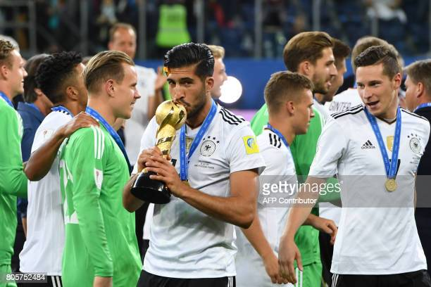Germany's midfielder Emre Can kisses the trophy after winning the 2017 Confederations Cup final football match between Chile and Germany at the Saint...