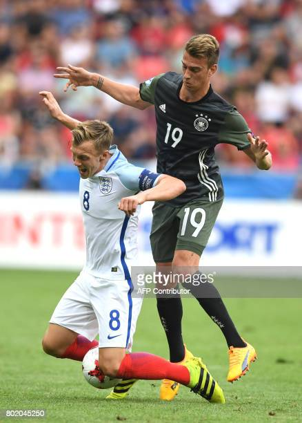 Germany's midfielder Janik Haberer and England's midfielder James WardProwse vie for the ball during the UEFA U21 European Championship football semi...