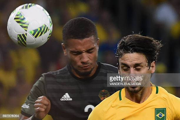 Germany's midfielder Jeremy Toljan vies with Brazil's defender Rodrigo Caio during the Rio 2016 Olympic Games men's football gold medal match between...