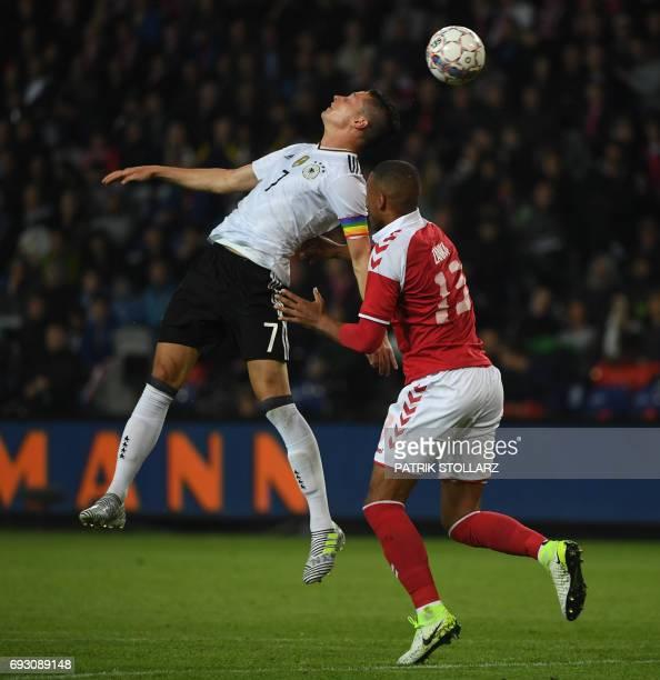 CORRECTION Germany's midfielder Julian Draxler and Denmark´s Martin Braithwaite vie for the ball during the friendly football match between Denmark...