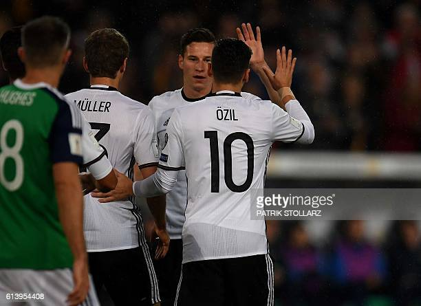 Germany's midfielder Julian Draxler and his teammates celebrate after scoring 10 during the WC 2018 football qualification match between Germany and...