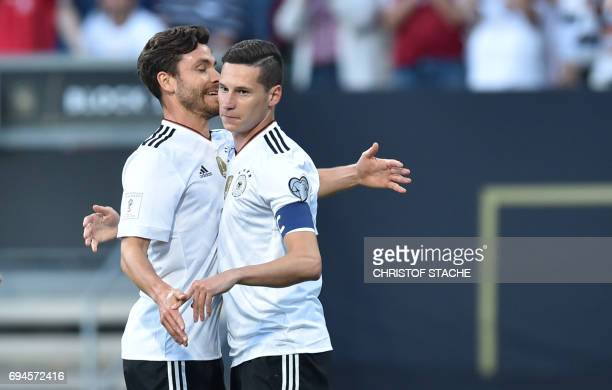 Germany's midfielder Julian Draxler celebrates scoring the opening goal with his teammate defender Jonas Hector during the FIFA World Cup 2018...