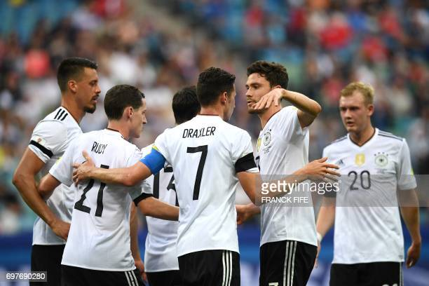 Germany's midfielder Julian Draxler celebrates with team mates after scoring a penalty during the 2017 Confederations Cup group B football match...