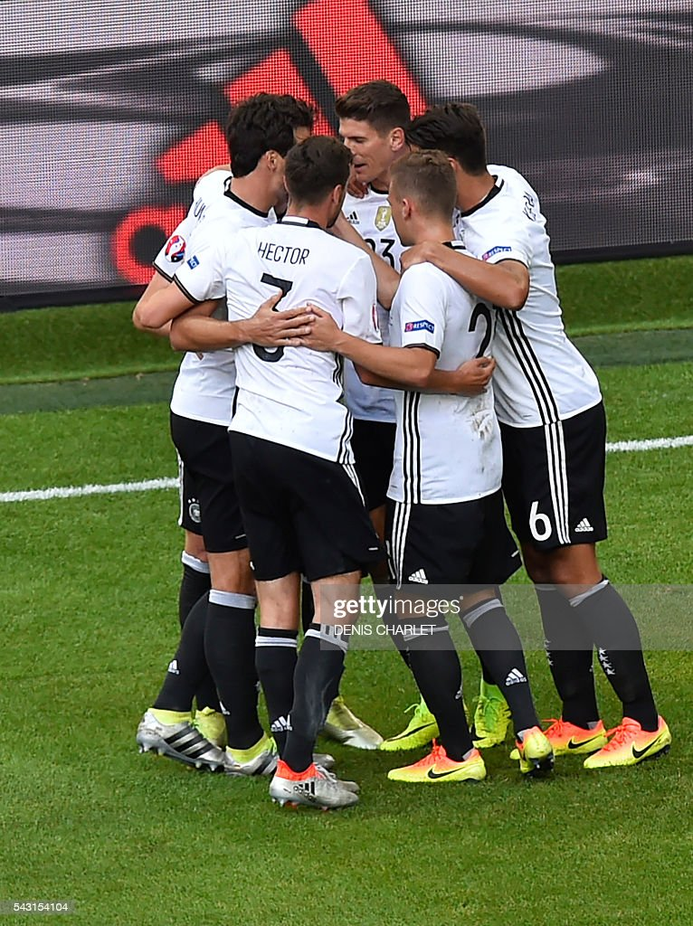 Germany's midfielder Julian Draxler celebrates with teammates after scoring during the Euro 2016 round of 16 football match between Germany and Slovakia at the Pierre-Mauroy stadium in Villeneuve-d'Ascq, near Lille, on June 26, 2016. / AFP / DENIS